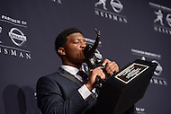 Jameis Winston kisses the Heisman Memorial Trophy after becoming the second freshman in Heisman Trophy history to win the award. As quarterback of the Florida State Seminoles, he led the team to an undefeated season and the ACC championship.  (Photo by Don Baxter/Media Images International)