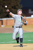 Aaron Bossi (17) of the Marshall Thundering Herd makes a throw to first base during infield practice prior to the game against the Georgetown Hoyas at Wake Forest Baseball Park on February 15, 2014 in Winston-Salem, North Carolina.  The Thundering Herd defeated the Hoyas 5-1.  (Brian Westerholt/Four Seam Images)