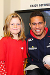 NELSON, NEW ZEALAND - July 26: Quentin Macdonald poses with a young fan during the Tasman Makos Family Fun Day at TRU Players Room, Trafalgar Park July 26, 2015 in Nelson, New Zealand. (Photo by Marc Palmano/Shuttersport Limited)