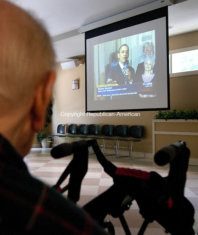 WOODBURY, CT. 08 June 2010-060810SV03--Sarge Towerof Woodbury watches President Barack Obama talk to seniors across the country about the new health care law on TV at the senior center in Woodbury Tuesday.<br /> Steven Valenti Republican-American