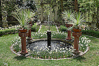 Water fountain feature in formal garden.