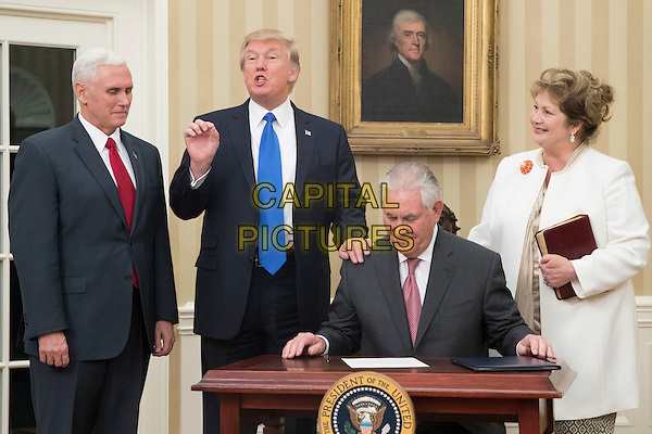 US President Donald J. Trump (2-L) reacts after Rex Tillerson (2-R) signed an appointment affidavit after being sworn-in as US Secretary of State by US Vice President Mike Pence (L), as Tillerson's wife Renda St. Clair (R) looks on; in the Oval Office of the White House in Washington, DC, USA, 01 February 2017. Tillerson was confirmed by the Senate, 01 February, in a 56-to-43 vote to become the nation's 69th Secretary of State.<br /> CAP/MPI/RS<br /> &copy;RS/MPI/Capital Pictures