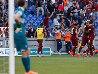 Calcio, Serie A: Lazio vs Roma. Roma, stadio Olimpico, 25 maggio 2015.<br /> Roma's Mapou Yanga-Mbiwa, right, celebrates with teammates after scoring the winning goal as Lazio's goalkeeper Federico Marchetti, left, reacts during the Italian Serie A football match between Lazio and Roma at Rome's Olympic stadium, 25 May 2015. Roma won 2-1.<br /> UPDATE IMAGES PRESS/Riccardo De Luca