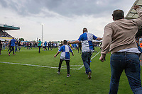 Fans run onto the pitch at full time of the Sky Bet League 2 match between Bristol Rovers and Dagenham and Redbridge at the Memorial Stadium, Bristol, England on 7 May 2016. Photo by Mark  Hawkins / PRiME Media Images.