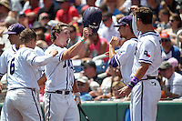 Cody Jones #1 of the TCU Horned Frogs celebrates during Game 3 of the 2014 Men's College World Series between the Texas Tech Red Raiders and TCU Horned Frogs at TD Ameritrade Park on June 15, 2014 in Omaha, Nebraska. (Brace Hemmelgarn/Four Seam Images)