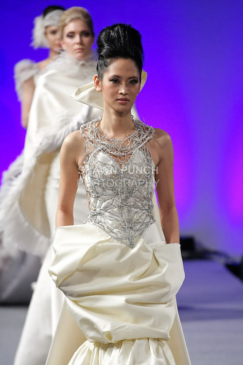 Elizabeth Thuytien walks runway in a wedding dress by Isabel Zapardiez, during Couture Fashion Week New York Fall 2012.