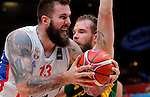 Serbia's Miroslav Raduljica (L) vies with Lithuania's Paulius Jankunas (R) during European championship semi-final basketball match between Serbia and Lithuania on September 18, 2015 in Lille, France  (credit image & photo: Pedja Milosavljevic / STARSPORT)