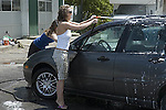 Teenagers operating charity car wash