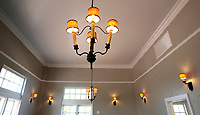 NWA Democrat-Gazette/DAVID GOTTSCHALK  Original restored light fixtures Tuesday, July 25, 2017, in one of the main rooms  at the new Haas Hall Academy Rogers Campus in Rogers. The campus is in the former historic Lane Hotel in the Rogers Commercial Historic District.