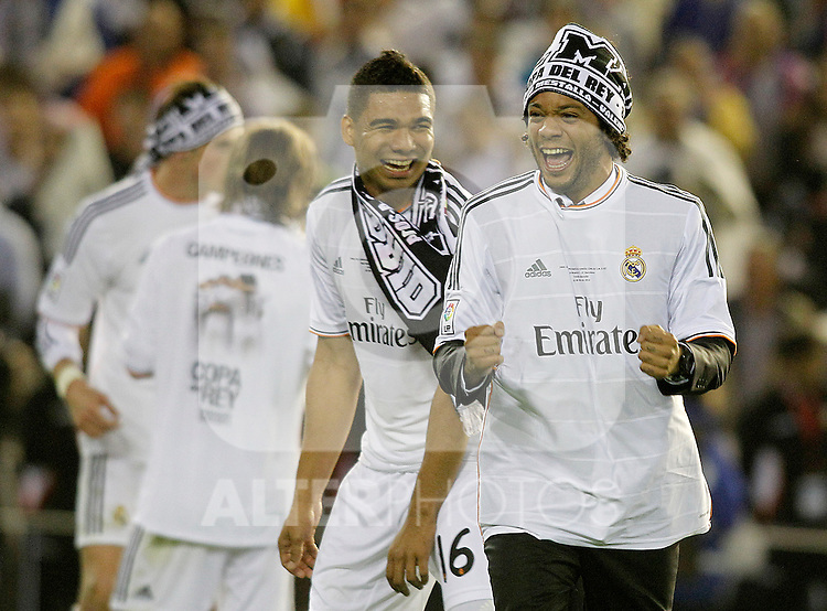 Real Madrid's Carlos Henrique Casemiro (l) and Marcelo Vieira celebrate the victory in the spanish KIng's Cup Final match.April 16,2014. (ALTERPHOTOS/Acero)