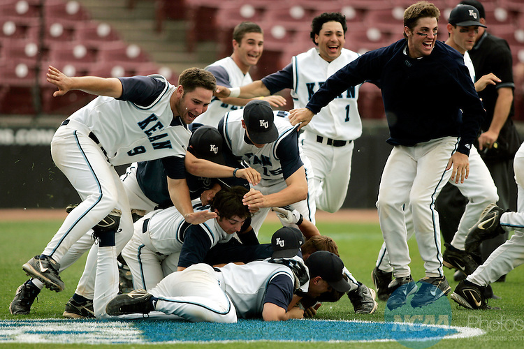 29 MAY 2007: Kean baserunner Joseph D'Andrea tackled to the ground as teammates look at another pile of players forming on the infield.  D'Andrea scored on Perry Schatzow's bases loaded single in the tenth inning of the NCAA Division III Men's National Baseball Championship held at Fox Cities Stadium in Grand Chute, WI.   Allen Fredrickson/NCAA Photos