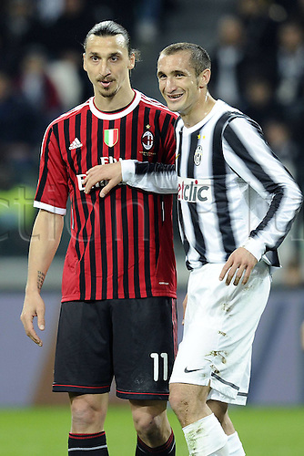 20.03.2012. Turin, Italy.  Coppa Italia versus Juventus Milan. Phtoo Giorgio Chiellini closely followed by Zlatan Ibrahimovic  The game ended in a 2-2 draw with Juventus going through to the next round 4-3 on aggregate.