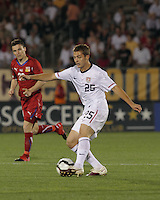 USA midfielder Robbie Rogers (25) passes the ball. In the Send Off Series, the Czech Republic defeated the US men's national team, 4-2, at Rentschler Field in East Hartford, Connecticut, on May 25, 2010.