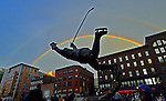 A double rainbow appears over a statue of Bruins great Bobby Orr as the Boston Bruins take on the Chicago Blackhawks at TD Garden on Monday, June 17, 2013. Boston Herald photo by Christopher Evans