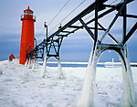 Ottawa County, MI   <br /> Grand Haven Lighthouse & ice coated catwalk over the frozen surface of Lake Michigan Grand Haven State Park