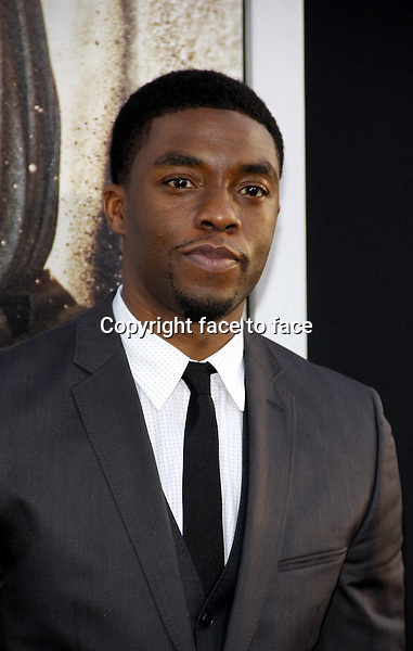 """Chadwick Boseman attending the """"42"""" Los Angeles Premiere at the TCL Chinese Theater on April 9, 2013 in Hollywood, California. ..Credit: PopularImages/face to face"""