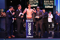 Mickey Burke on the scales during a Weigh In at the BT Studios, Queen Elizabeth Olympic Park on 12th July 2019