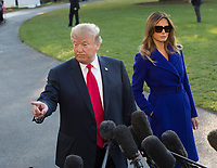 United States President Donald J. Trump speaks to the media as first lady Melania Trump looks on before departing the White House in Washington, DC, November 3, 2017 for a multi-day trip to Hawaii and then on to Asia. Credit: Chris Kleponis / CNP /MediaPunch