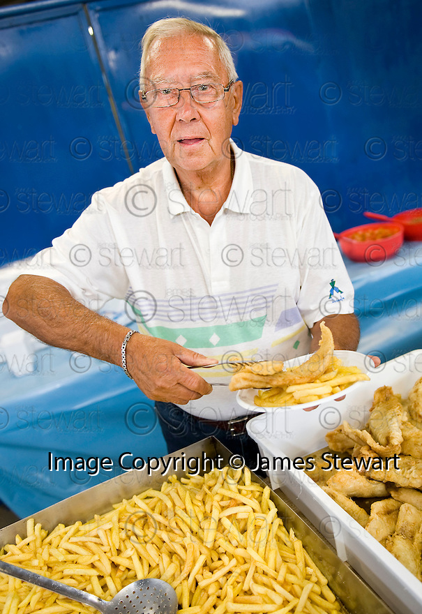 "SAGRA DEL ""PESCE E PATATE"" 2011, BARGA, ITALY<br /> <br /> ONE OF THE PIONEERS OF THE FESTIVAL, MARCO MARCHETTI (80), RETURNS TO HELP SERVE UP THE FISH AND CHIPS."