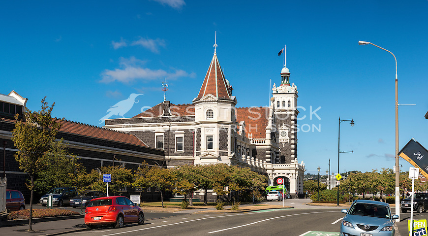 Side view of the iconic Dunedin Railway Station on a blue sky day, Dunedin City, Otago, New Zealand - stock photo, canvas, fine art print