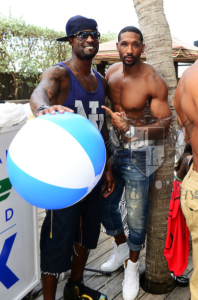 MIAMI BEACH, FL - JUNE 21: Plaxico Burress and Mark Boson attend  DJ Irie Weekend-IWX - BBQ Beach Bash Pool Party at National Hotel on Saturday June 21, 2014 in Miami Beach, Florida. (Photo by Johnny Louis/jlnphotography.com)