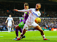 Leeds United's Kemar Roofe holds off the challenge from Bristol City's Jamie Paterson<br /> <br /> Photographer Alex Dodd/CameraSport<br /> <br /> The EFL Sky Bet Championship - Leeds United v Bristol City - Saturday 24th November 2018 - Elland Road - Leeds<br /> <br /> World Copyright &copy; 2018 CameraSport. All rights reserved. 43 Linden Ave. Countesthorpe. Leicester. England. LE8 5PG - Tel: +44 (0) 116 277 4147 - admin@camerasport.com - www.camerasport.com