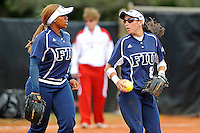 11 February 2012:  FIU's Jessy Alfonso (8) speaks with Ashley McClain (2) during a break in the action as the University of Louisville Cardinals defeated the FIU Golden Panthers, 4-2, as part of the COMBAT Classic at the FIU Softball Complex in Miami, Florida.