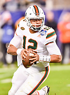 Charlotte, NC - DEC 2, 2017: Miami Hurricanes quarterback Malik Rosier (12) rolls out of the pocket during ACC Championship game between Miami and Clemson at Bank of America Stadium Charlotte, North Carolina. (Photo by Phil Peters/Media Images International)