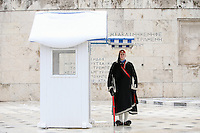 Pictured: A Tsolias or member of the Prsidential Guard wears a thick coat as kiosk he stands next to is covered in thick snow, Athens, Greece. Tuesday 10 January 2017<br /> Re: Heavy snow fall and minus zero temperatures have affected most parts of eastern Europe and Greece.