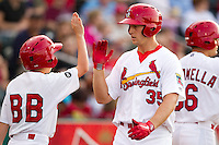 Kyle Conley (35) of the Springfield Cardinals celebrates with teammates after hitting a home run during a game against the Arkansas Travelers at Hammons Field on June 12, 2012 in Springfield, Missouri. (David Welker/Four Seam Images).