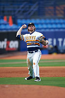 Canisius College Golden Griffins third baseman Liam Wilson (33) throws to first base during the second game of a doubleheader against the Michigan Wolverines on February 20, 2016 at Tradition Field in St. Lucie, Florida.  Michigan defeated Canisius 3-0.  (Mike Janes/Four Seam Images)