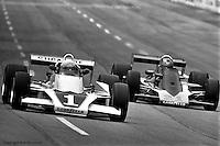 HAMPTON, GA - APRIL 22: Tom Sneva (#1 McLaren M24/Cosworth TC) and Lee Kunzman (#Parnelli VPJ6/Cosworth TC drive into Turn #1 during the Gould Twin Dixie 125 event on April 22, 1979, at Atlanta International Raceway near Hampton, Georgia.