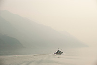 Daytime landscape view of river patrol boat on the Cháng Jiāng in the Yiling District of Yichang in Hubei province.  © LAN
