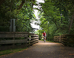 Man on bike path bicycling