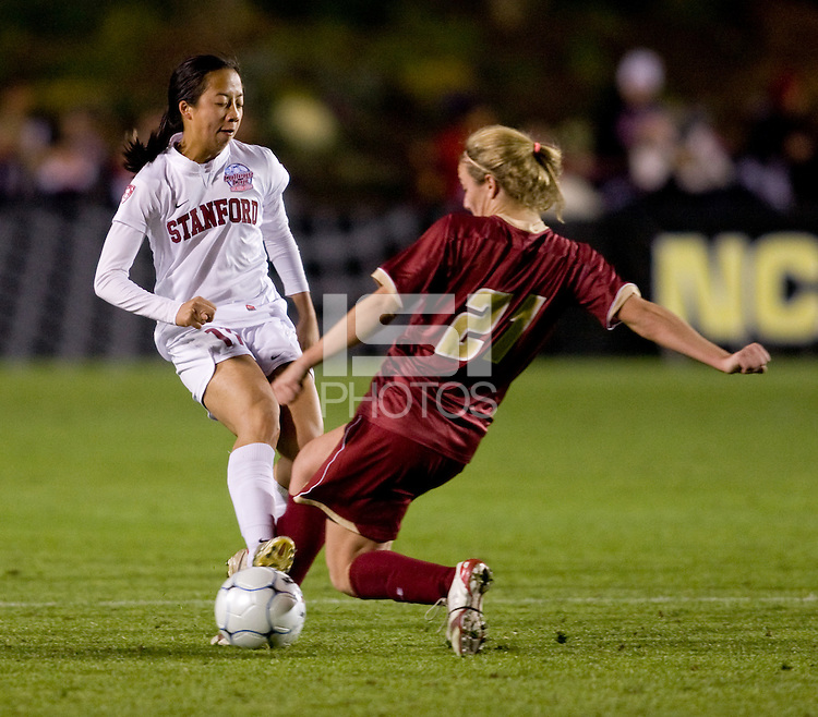 Kate McCarthy (21) of Boston College collides with Rachel Quon (11) of Stanford during the second game of the NCAA Women's College Cup at WakeMed Soccer Park in Cary, NC.  Stanford defeated Boston College, 2-0.