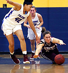 WATERBURY CT. 18 February 2018-021819SV03-#24 Hailey Deitlebaum of Naugatuck High dives for the loose ball as #42 Jade Udoh of St. Paul High defends during the NVL semi final at Kennedy High in Waterbury Monday.<br /> Steven Valenti Republican-American