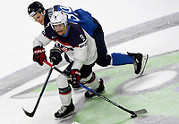 American Andrew Copp (front) and Finland's Jesse Puljujarvi fight for the puck during the Ice Hockey World Championship quarter-final match between the US and Finland in the Lanxess Arena in Cologne, Germany, 18 May 2017. Photo: Monika Skolimowska/dpa /MediaPunch ***FOR USA ONLY***