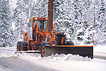 Snow plow clearing roadway near Sounth Lake Tahoe, California