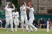 Jamie Porter of Essex is congratulated by his team mates after taking the wicket of Rory Burns during Surrey CCC vs Essex CCC, Specsavers County Championship Division 1 Cricket at Guildford CC, The Sports Ground on 9th June 2017