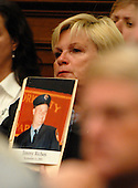 Washington, D.C. - June 25, 2007 -- Unidentified family member holds a photo as former Environmental Protection Agency (EPA) Administrator Christine Todd Whitman testifies before the United States House Constitution, Civil Rights, and Civil Liberties Subcommittee hearing on post 9/11 air quality in New York and the area surrounding the Twin Towers in Manhattan in Washington, D.C. on Monday, June 25, 2007.<br /> Credit: Ron Sachs / CNP<br /> (RESTRICTION: No New York or New Jersey newspapers or Newspapers within a 75 mile radius of New York City)