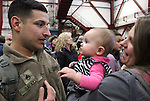 Ava Salazar, 6 months, gets her first look at her daddy Staff Sgt. Mike Salazar when he and more than 300 members of the 422nd Expeditionary Signal Battalion of the Nevada National Guard returned home Sunday, Jan. 15, 2012, after a yearlong deployment to Afghanistan. Mom Vera Salazar was among hundreds of family and friends who greeted the soldiers at the Nevada Air Guard Base in Reno, Nev..Photo by Cathleen Allison