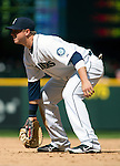 Seattle Mariners' first baseman Justin Smoak gets set in the eight  inning against the Texas Rangers on April 14, 2013 at Safeco Field in Seattle.  © 2013. Jim Bryant Photo. All Rights Reserved.