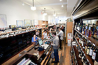 Customers shop at Chambers Street Wines in New York, NY, USA, 22 May 2009. The store specializes in naturally made wines from artisanal small producers and has received a Slow Food NYC Snail of Approval.