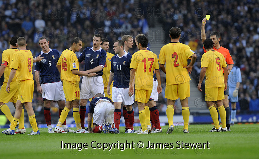 05/09/2009  Copyright  Pic : James Stewart.sct_jspa07_scotland_v_macedonia  .IGOR MITRESKI (5) IS BOOKED AFTER HE TAKES STEVEN FLETCHER FROM BEHIND ....James Stewart Photography 19 Carronlea Drive, Falkirk. FK2 8DN      Vat Reg No. 607 6932 25.Telephone      : +44 (0)1324 570291 .Mobile              : +44 (0)7721 416997.E-mail  :  jim@jspa.co.uk.If you require further information then contact Jim Stewart on any of the numbers above.........