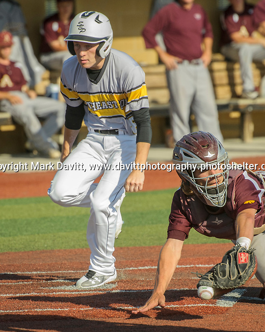 Southeast Polk and Ankeny met for a double header at SEP June 21. SEP prevailed twice, 2-0 and 8-1. SEP's Payne Roberts safely crosses home plate.