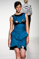 Model walks runway in an outfit from the Elytra collection by Hannah Peyers, during the Pratt 2011 fashion show.