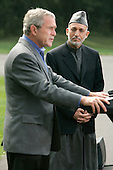 U.S. President George W. Bush (L) and Afghan President Hamid Karzai hold a joint press conference in Camp David Maryland, USA on Monday 06 August 2007. Karzai's two-day visit to the Presidential mountain retreat included discussions of trouble at home, including a hostage crisis and a resurgent Taliban.