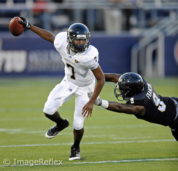 30 March 2012:  FIU's E.J. Hilliard (7) evades Giovani Francois (9) at the FIU Football Spring Game at University Park Stadium in Miami, Florida.