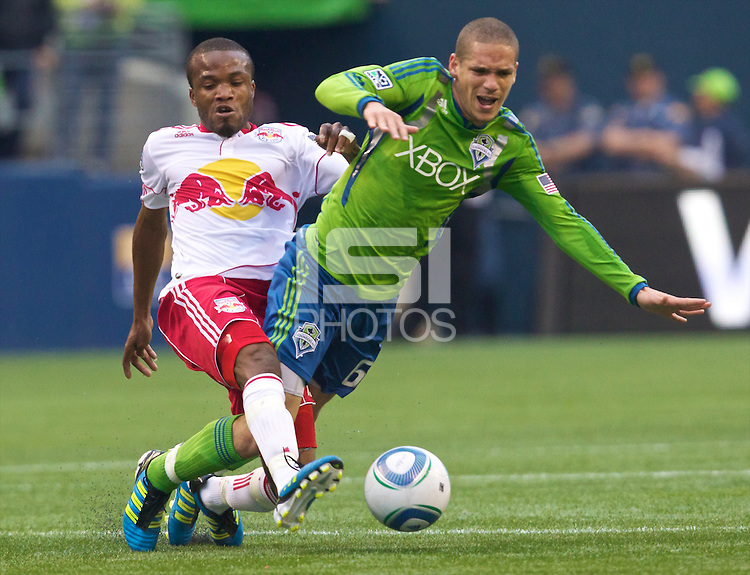 New York Red Bulls forward Dane Richards fouls Seattle Sounders FC defender Osvaldo Alonso  during play at Qwest Field in Seattle Saturday June 23, 2011. The Sounders won the game 4-2.