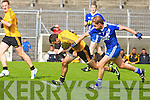 Listowel Emmets Denis Walsh pulls away from Lios Poil's Kieran O'Driscoll in the intermediate championship semi-final at Austin stack park, Tralee on Sunday.